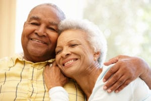 older African American couple smiling and enjoying life
