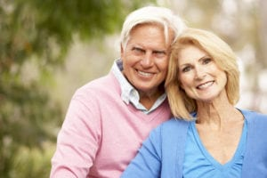 portrait of smiling older couple outside