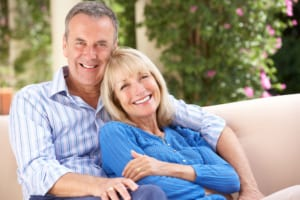 smiling older couple relaxing at home