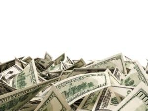 pile of money against plain white background