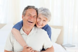 smiling elderly couple in their home