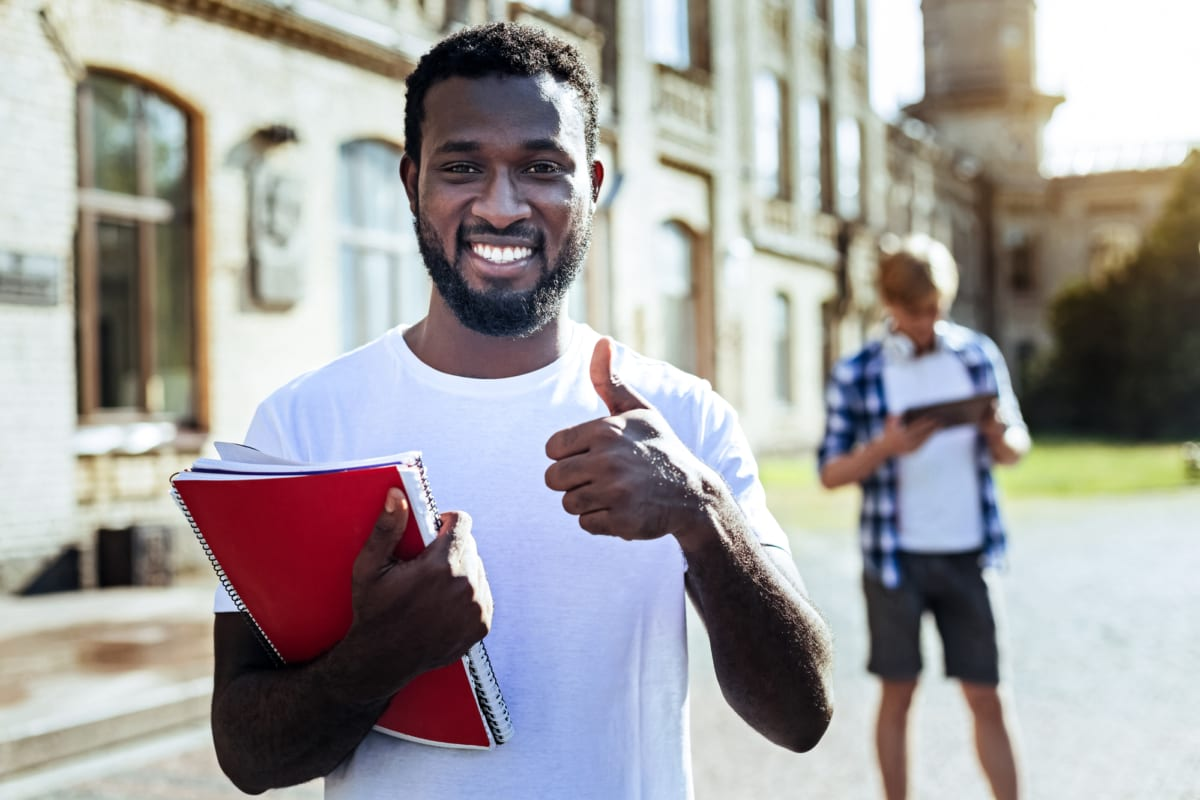 young African-American man smiling and giving thumbs-up