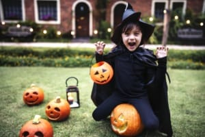 photo of girl dressed in witch costume on Halloween