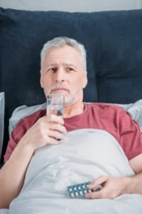 man recovering after oral surgery