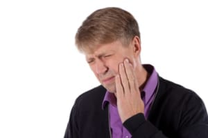 man in suit experiencing jaw pain