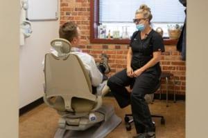 dental hygienist speaking with patient