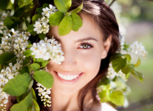 young woman with beautiful smile enjoying the outdoors