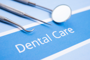 dental tools on a blue paper