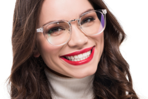 woman with glasses showing off a smile with porcelain crowns